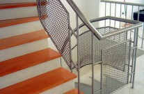 Railing with protective mesh